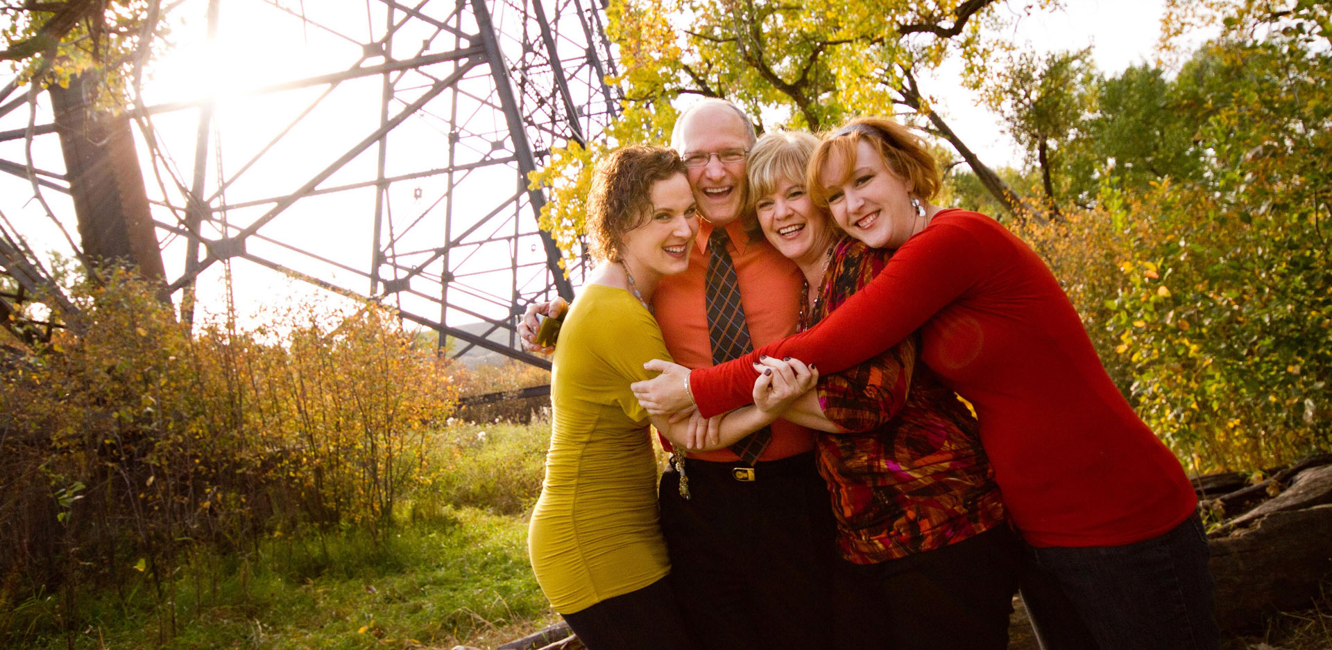 Fun autumn photo in Indian Battle Park of family hugging