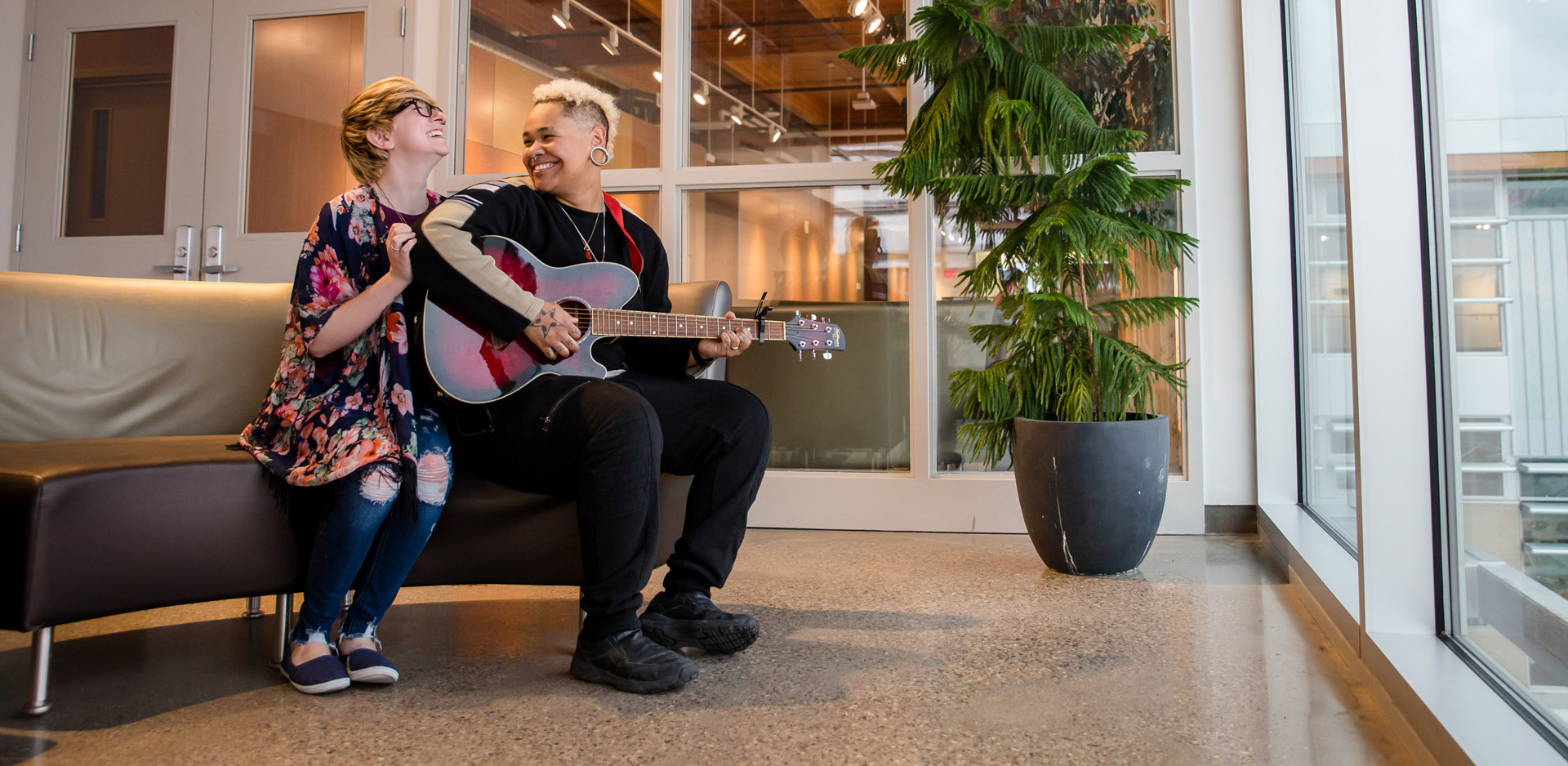 Engaged couple laughing with guitar at Casa