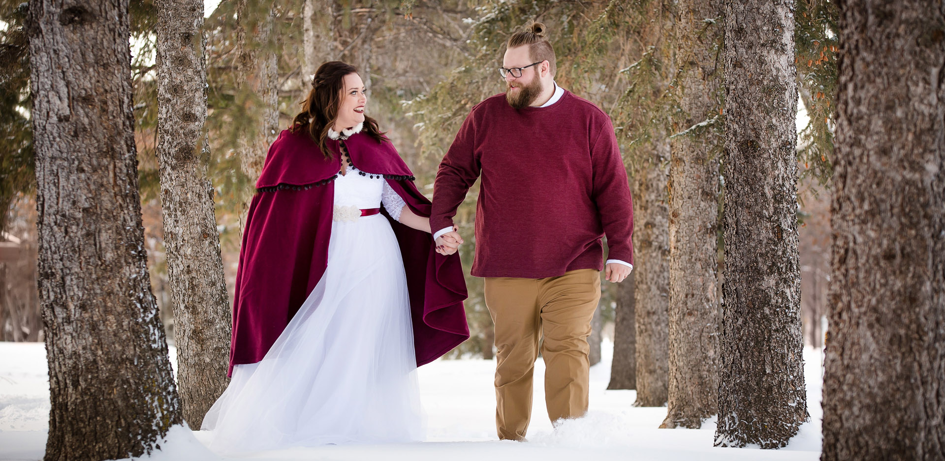 Red cape winter wedding at Henderson Lake