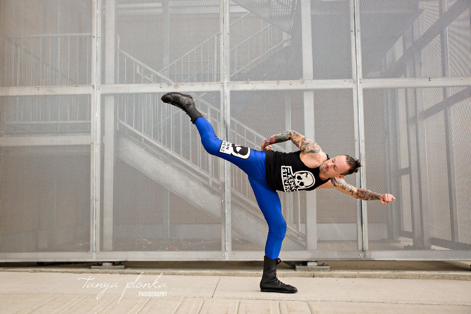 Wrestler kicks high in air
