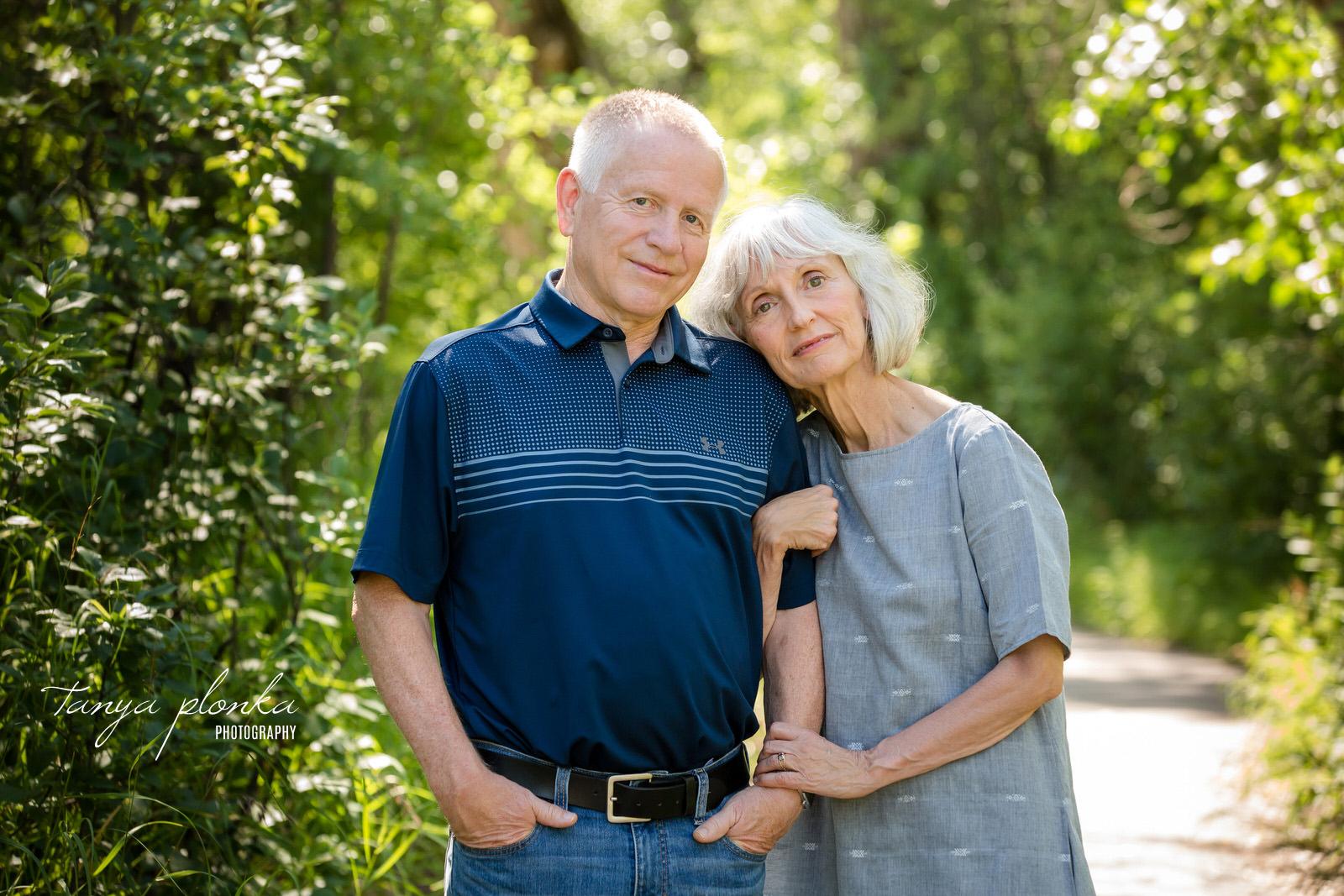 woman leans on her husband's shoulder