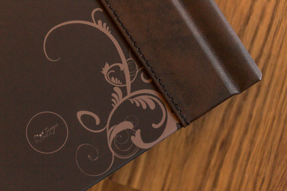 close detail photo of stitching on album leather spine