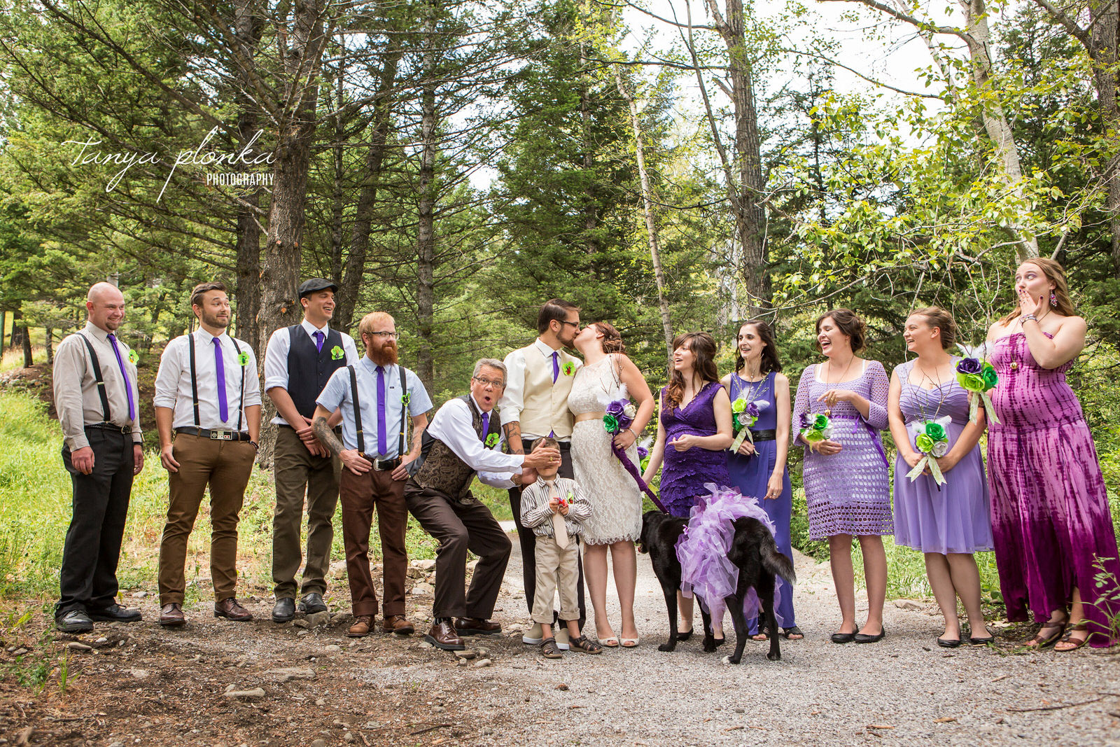 wedding party reacting to bride and groom kissing