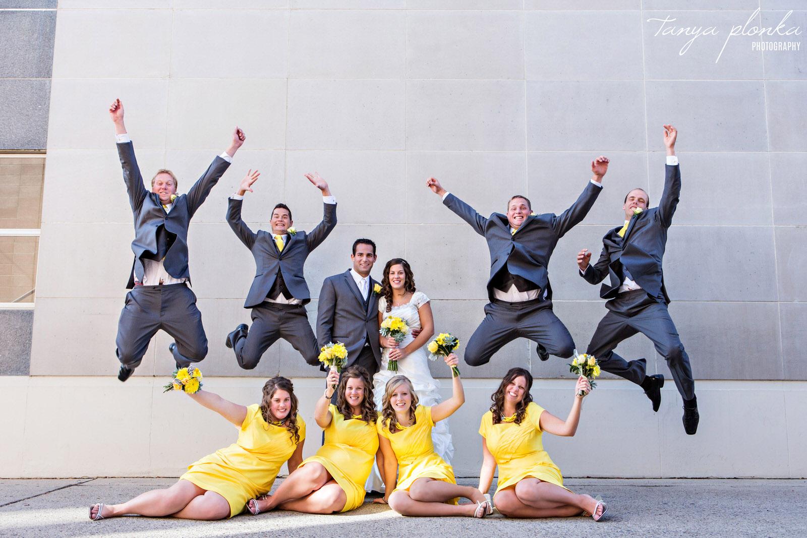 groomsmen jumping in downtown Lethbridge wedding party photo