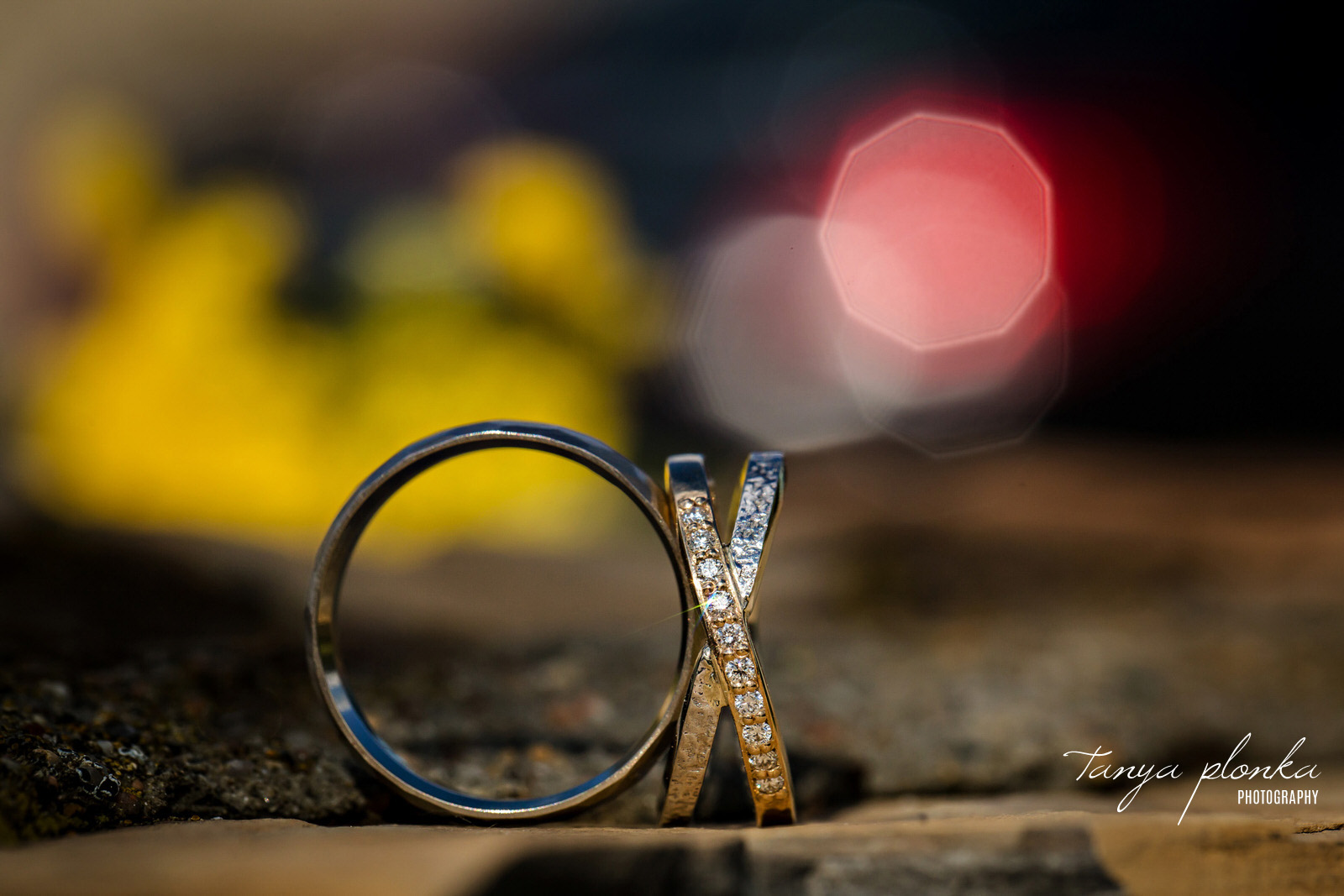 wedding rings are placed on their sides to look like OX