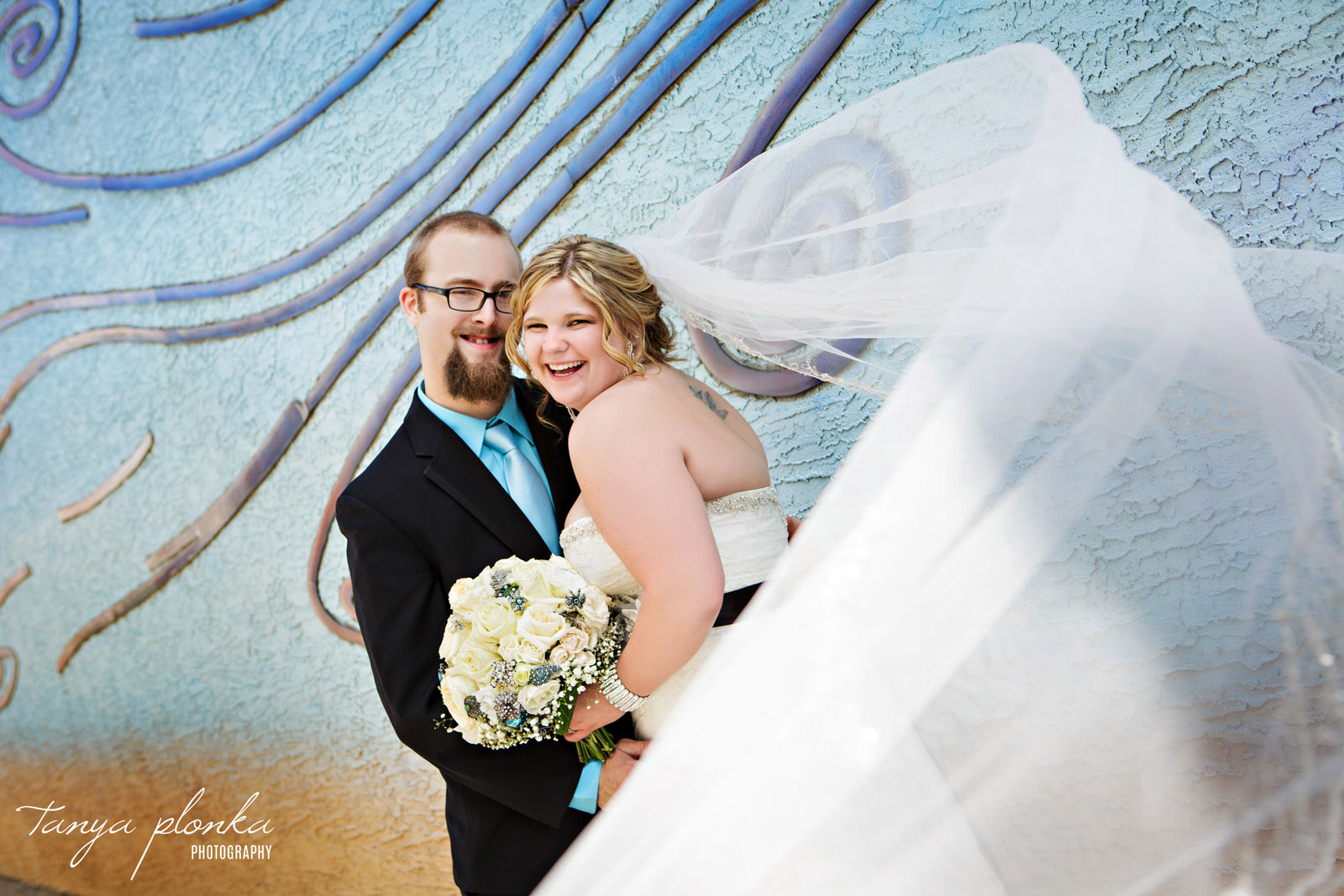 bride's veil blows in the wind in downtown Lethbridge