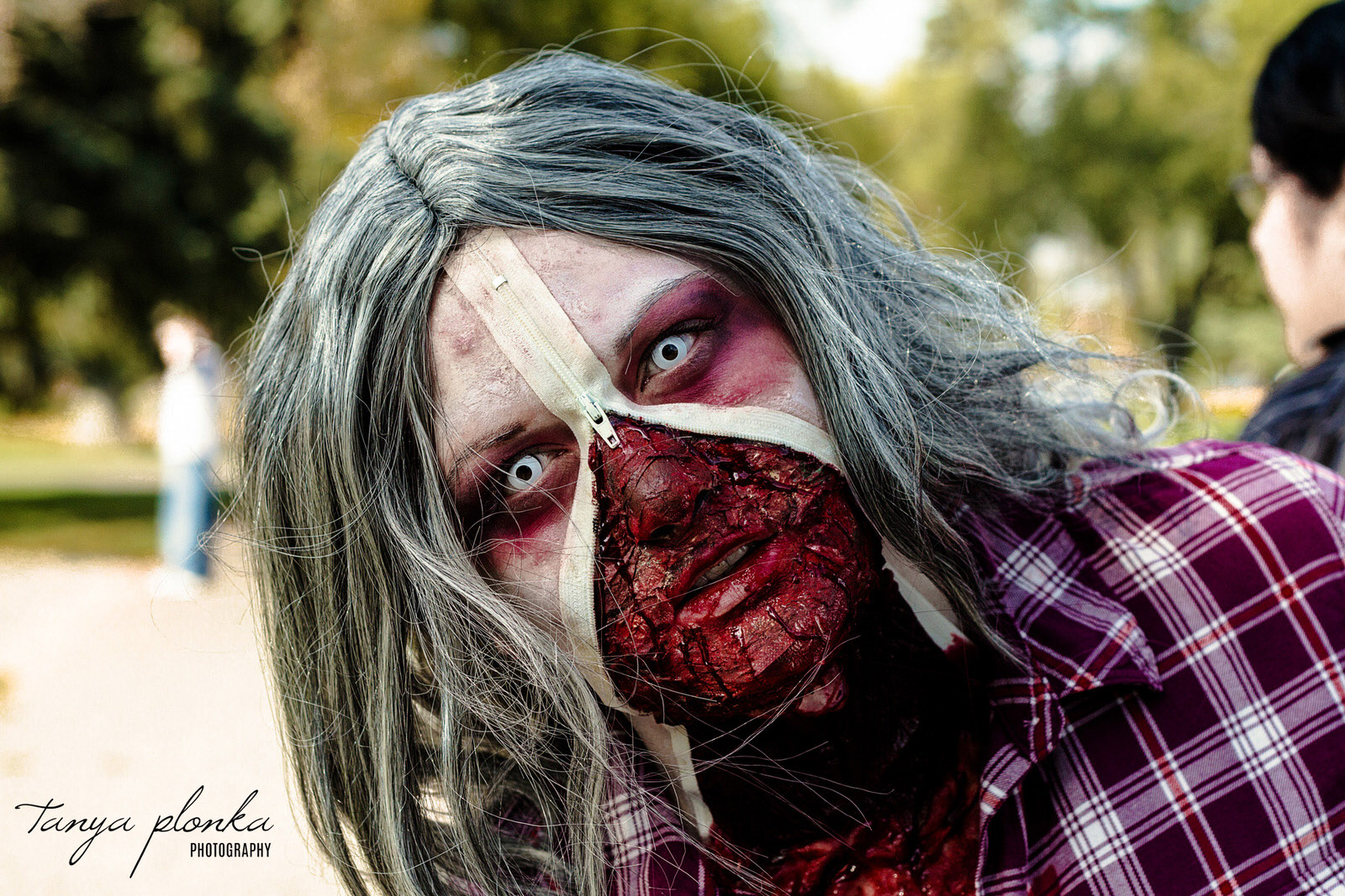 woman dressed as zombie with zipper face at the Lethbridge Zombie Walk