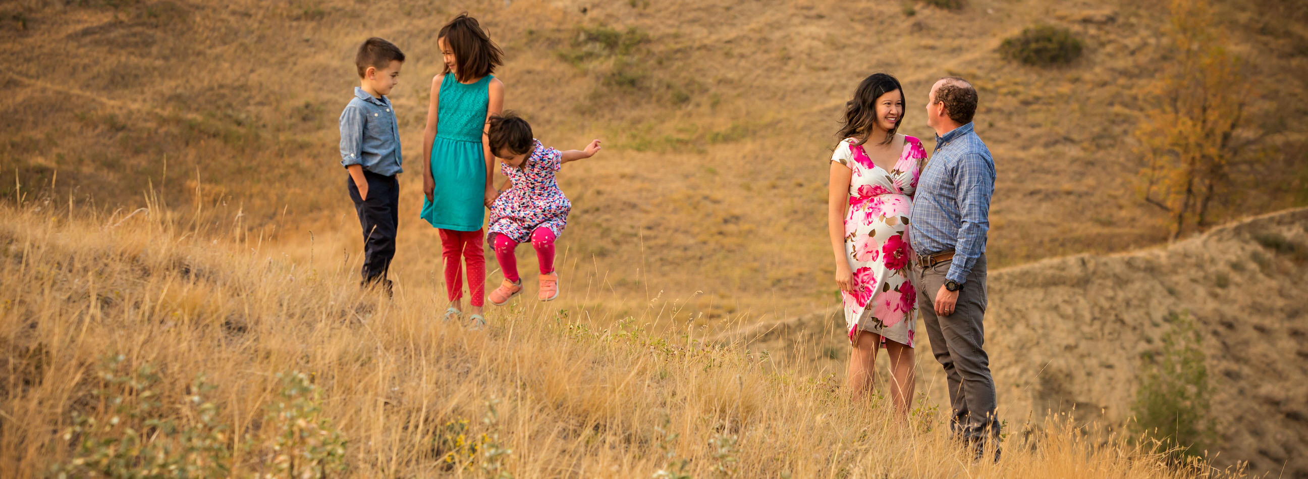 Melissa testimonial, family photo in coulees with child jumping