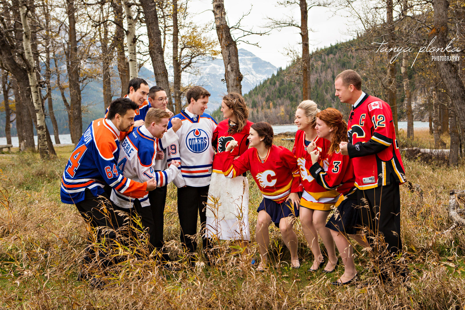 wedding party with Oilers and Calgary Flames jerseys faces off in Waterton National Park